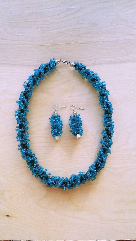 Check out this item in my Etsy shop https://www.etsy.com/listing/482939271/halloween-spooky-blue-long-necklace