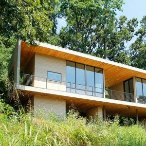 Studio+building+by+Hanrahan+Meyers+rises+up+from+a+forested+hillside+in+Pennsylvania