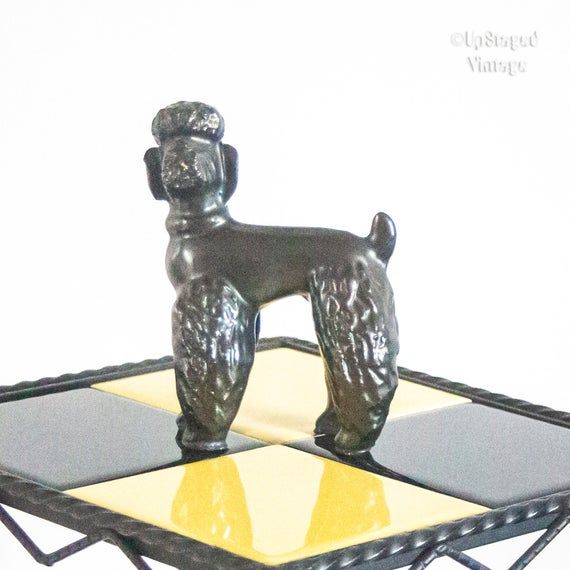 Bienvenue à UpStaged VintageThis listing includes FREE shipping to the UK, France and most of EuropeThis wonderful little black plaster poodle ornament is totally original French vintage and is in remarkable condition considering its age and material.Great as a display item, a lovely talking point and delightfully cute and kitsch. A great gift for any poodle lover, especially if they like vintage collectables. In VERY GOOD vintage condition but with a few knocks and bumps you might expect a plas