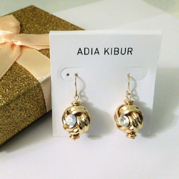 Knot & Crystal Earrings Intertwined gold metal surrounds a round crystal stone in both front and back of dangling earring.  Customer rating:  ????? Adia Kibur Jewelry Earrings