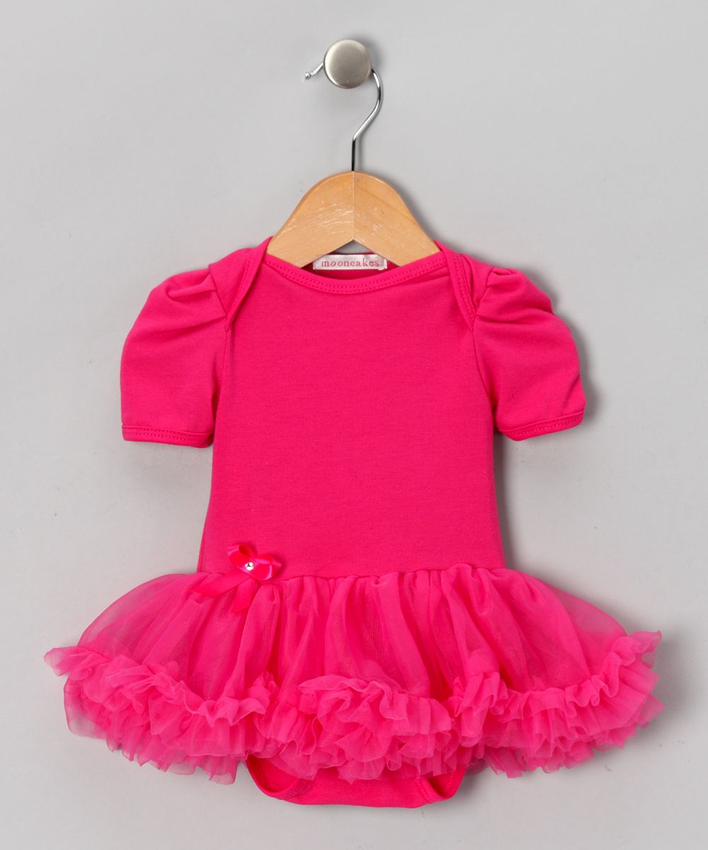 14.99    Ballerina meets baby in this girly bodysuit. Changing is quick and easy with its bottom snap closures and lap neck, while a rhinestone-studded bow adds the perfect final touch.