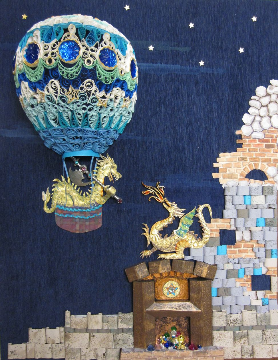 """Naomi Lipsky My work uses quilling, which is the craft of rolled paper, or paper filigree.  In this piece, the 3-d hot air balloon is 2 1/2"""" deep.  It is all paper, except for the blue """"jewels"""".  I am also a gilder, so some of the rolled paper is edged with 23k gold leaf. The castle wall stones are also rolled paper antiqued with gouache, and the bricks are painted with gouache.  The dragon in the balloon is image# 995593-039, and the castle dragon is #423107-014a."""