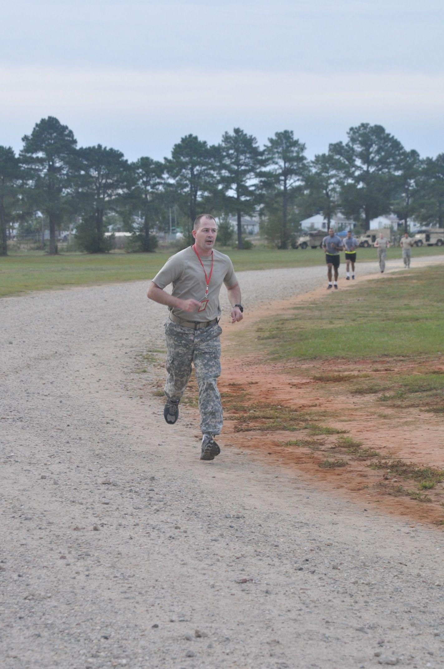 1st. Lt. John Galan finishing the twomile run portion of