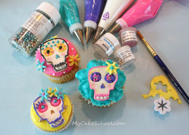Piped chocolate into silicone ice cube trays and decorated for Dia de los Muertos. Love it! ~via mycakeschool.com