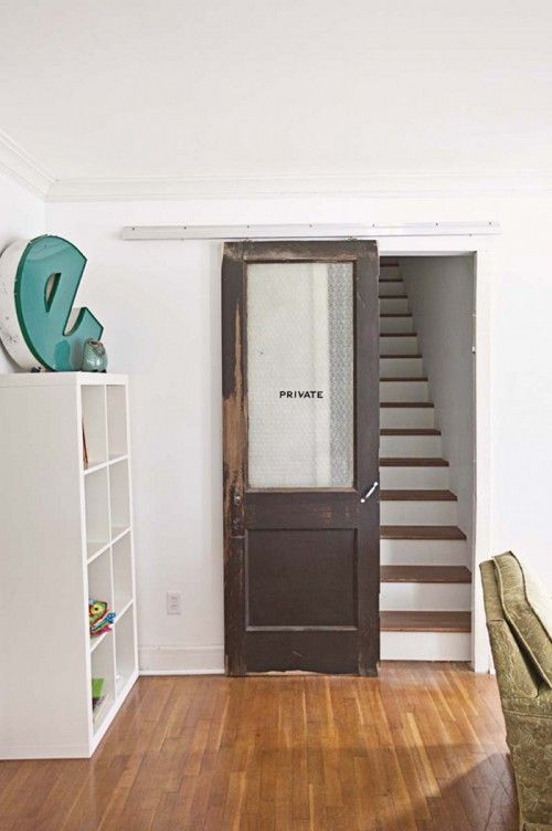 "An eclectic family home in Springfield, MO: ""Everyone loves our ""private"" door which we salvaged from a high school reno here in town. It leads up our new staircase (which used to be a coat closet) to our master suite. So it's pretty fitting!"""