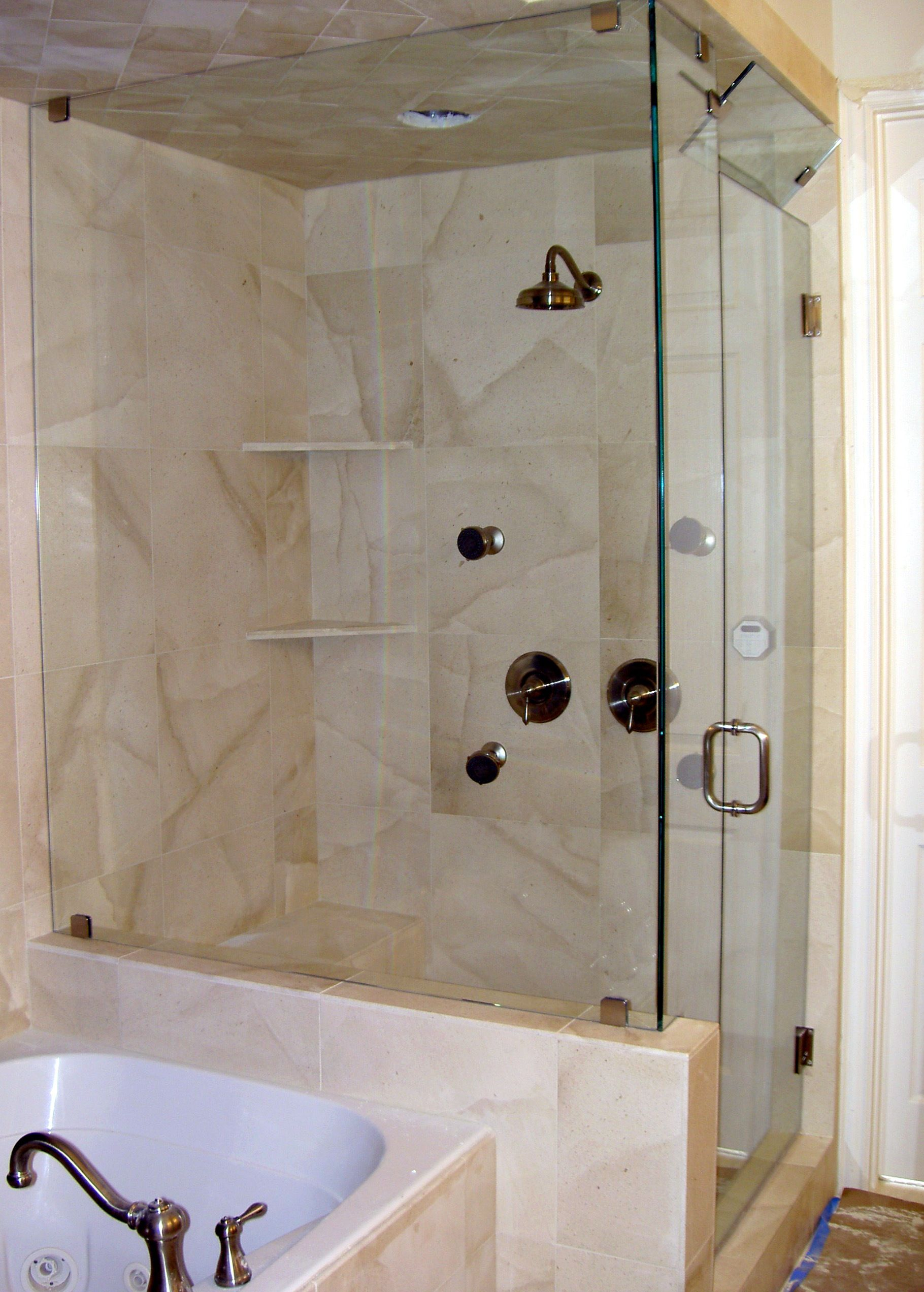 Bathroom with corner shower - Shower With Partial Wall Modernize Your Bathroom With A Frameless Shower Enclosure