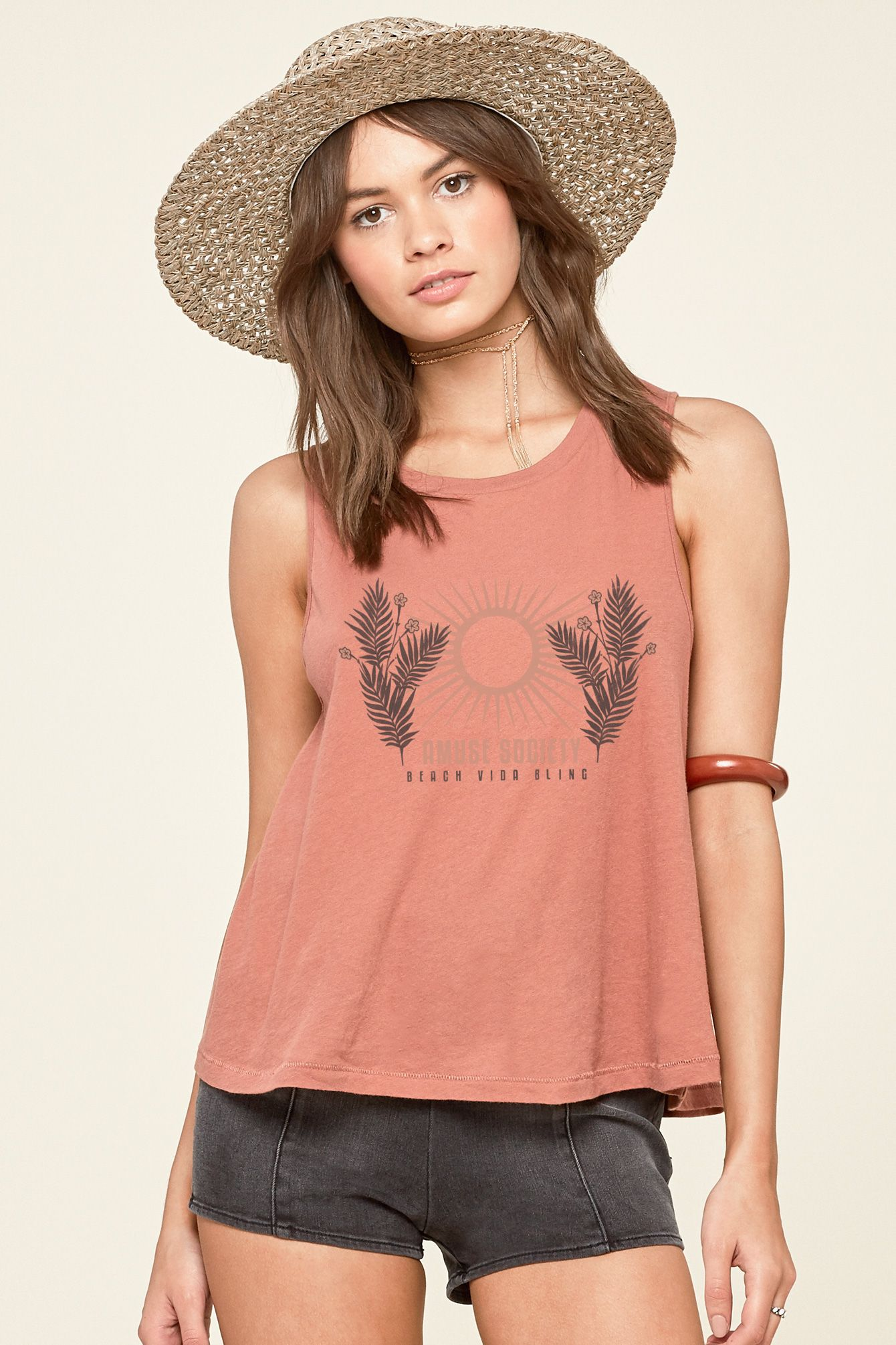 The Palm Rays Tank is a loose knit tank with rib knit detail and screen print at chest.