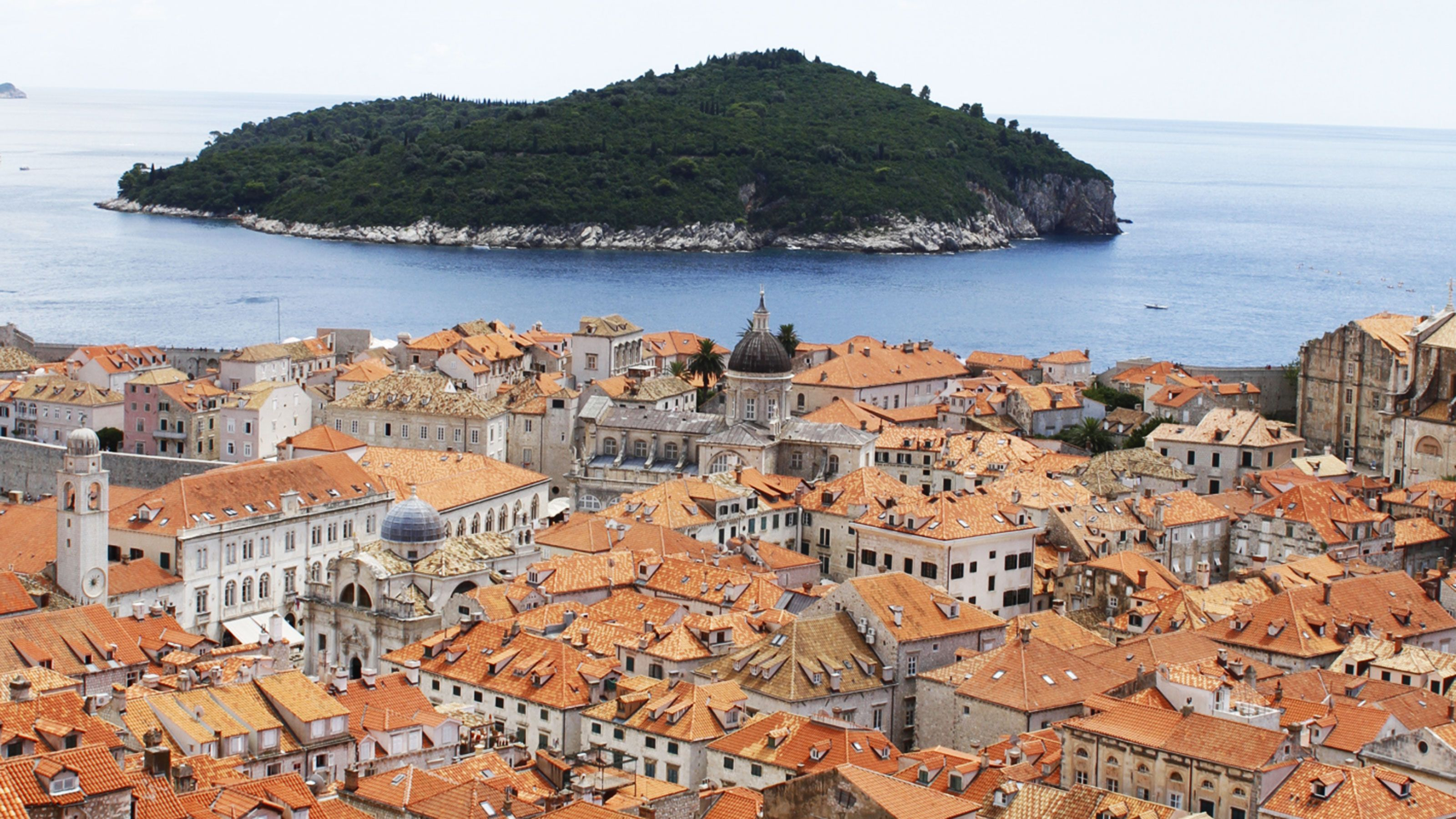Orange rooftops in Croatia. Continue your colorful adventure, here, with Epic Journeys.