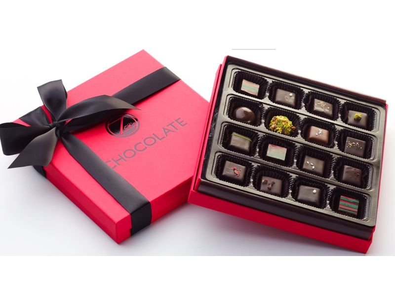 Fabulously Festive Chocolates. The Mediterranean Inspired Collection and The Caramel Collection are both available in our signature red holiday boxes, tied with a black satin ribbon.  The assortments include scrumptious seasonal flavors such as Dark Chocolate Chestnut, Black Daphne (dark chocolate with Mavrodaphne, an exotic port-like wine from the Peloppenese region in Greece) and Gingerbread Cookie chocolate. For ordering information make sure to check out our website at…