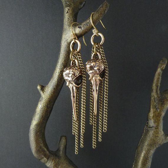 Handmade bronze earrings from Canada    Very beautiful hummingbird skulls with bronze chains. Beautiful designed with a flower on the skull. Looks amazing    The description on the website is in Danish, but if you have any questions feel free to ask