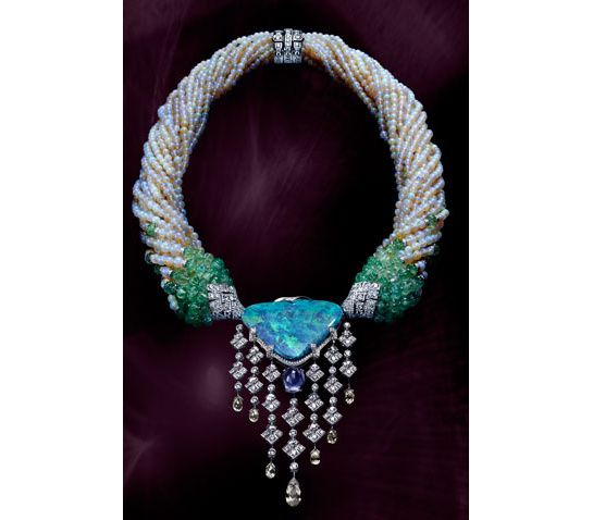 A DROP DEAD GORGEOUS Platinum Necklace by Cartier  ...a HUGE 35.52 carat Opal... one 8.50 carat pear sapphire  cabachon....8 diamond briolettes  via Vogue.com