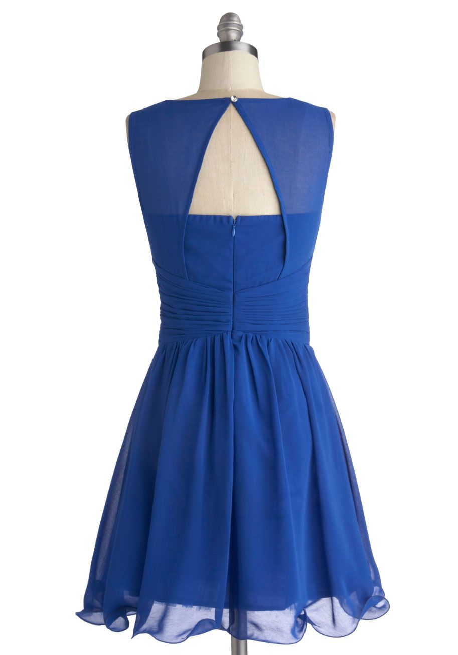 Sleeveless sapphire ModCloth dress, rear view. Satin sweetheart underlay with padded cups and chiffon overlay with jewel neck, silver beading around edges of bodice and center front ruching, triangular keyhole back with silver button closure and exposed underlay, very wide pleated faux-wrap cummerbund waistband, closely gathered above-the-knee A-line skirt, and back invisible zipper w/ hook & eye. 100% polyester, $109.99