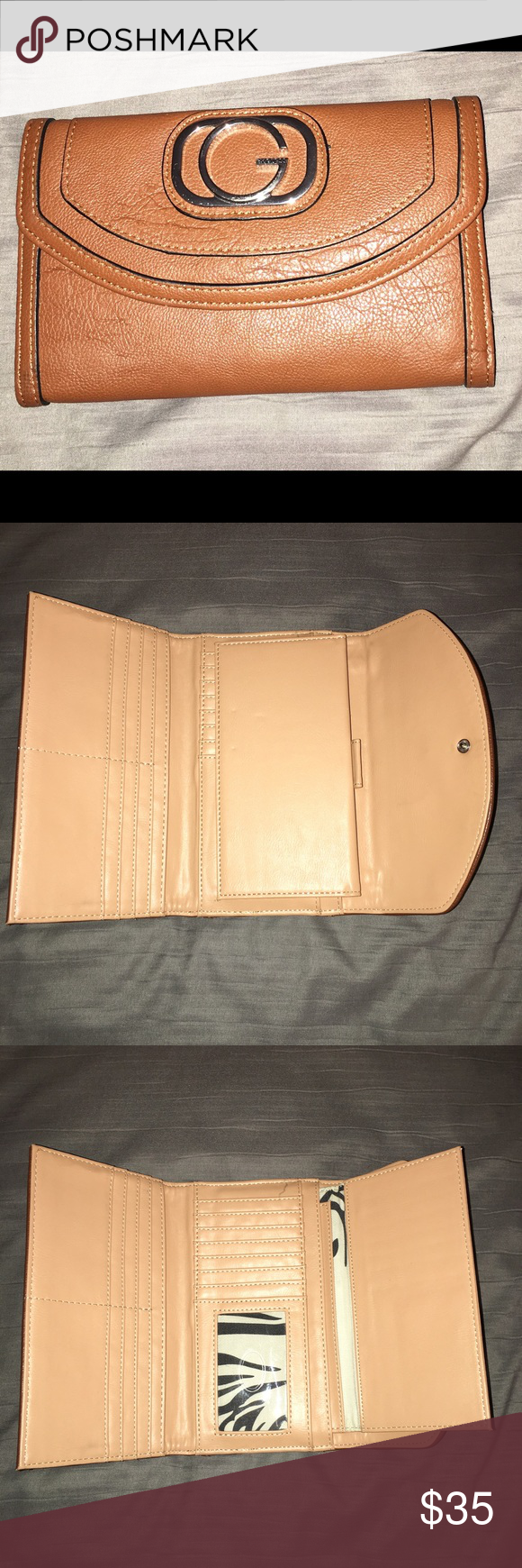 Wallet Used Guess wallet.  Large size.  Shows signs of normal wear. Good condition Guess Bags Wallets