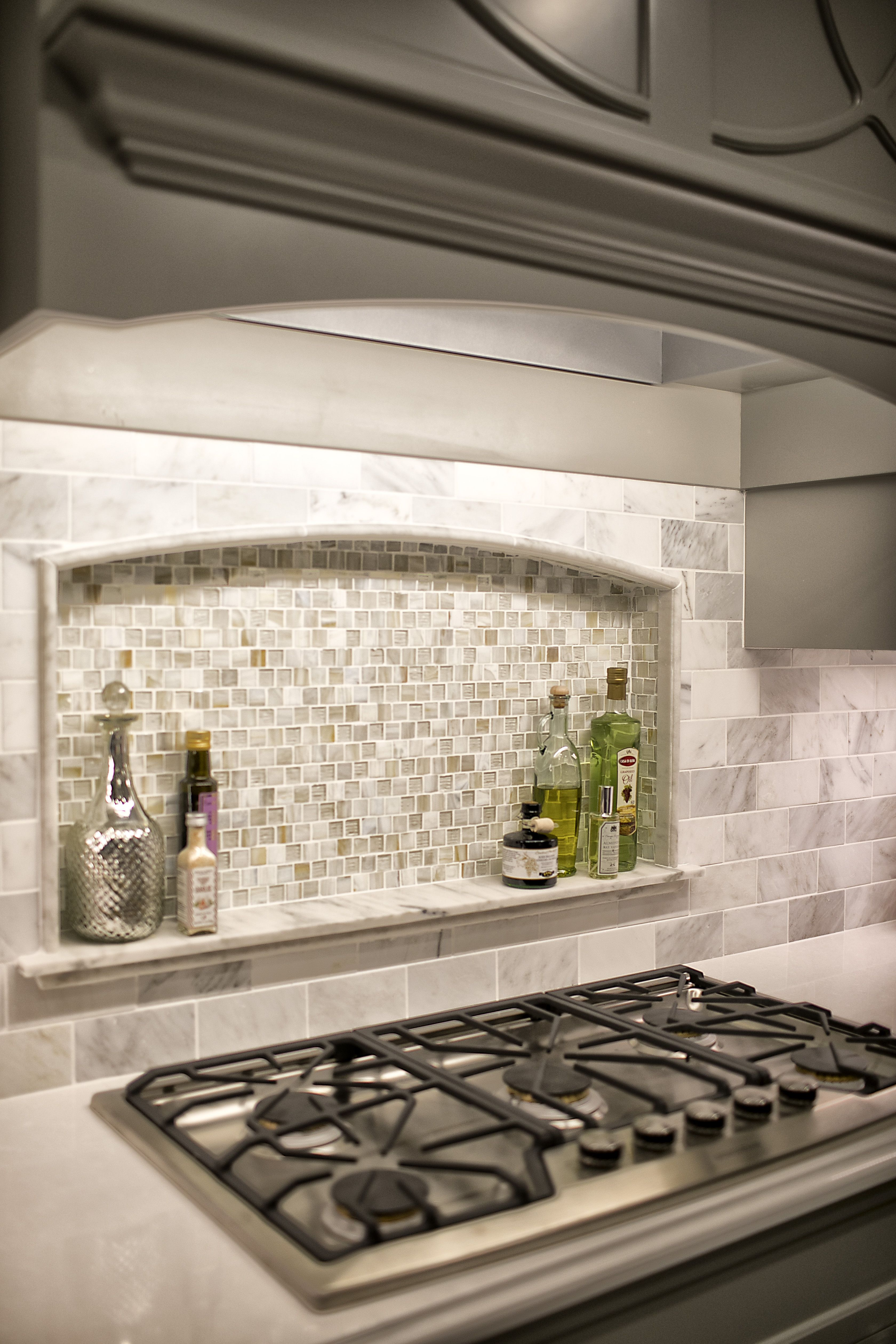 custom niche in kitchen backsplash with marble ledge. marble