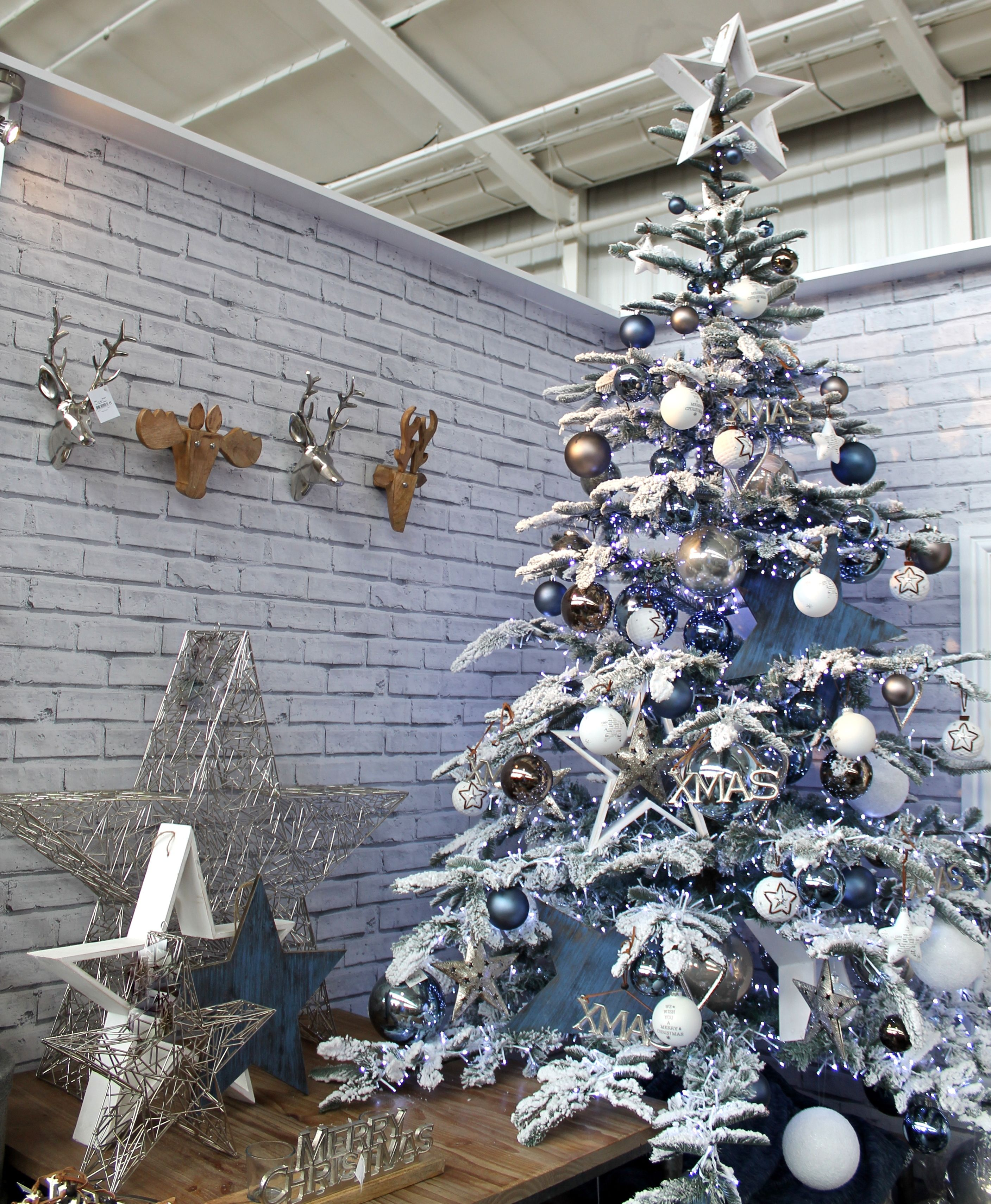Urban Christmas Tree Design With A Blue Grey And White Colour Scheme Christmas Tree Design Flocked Christmas Trees Decorated Grey Christmas