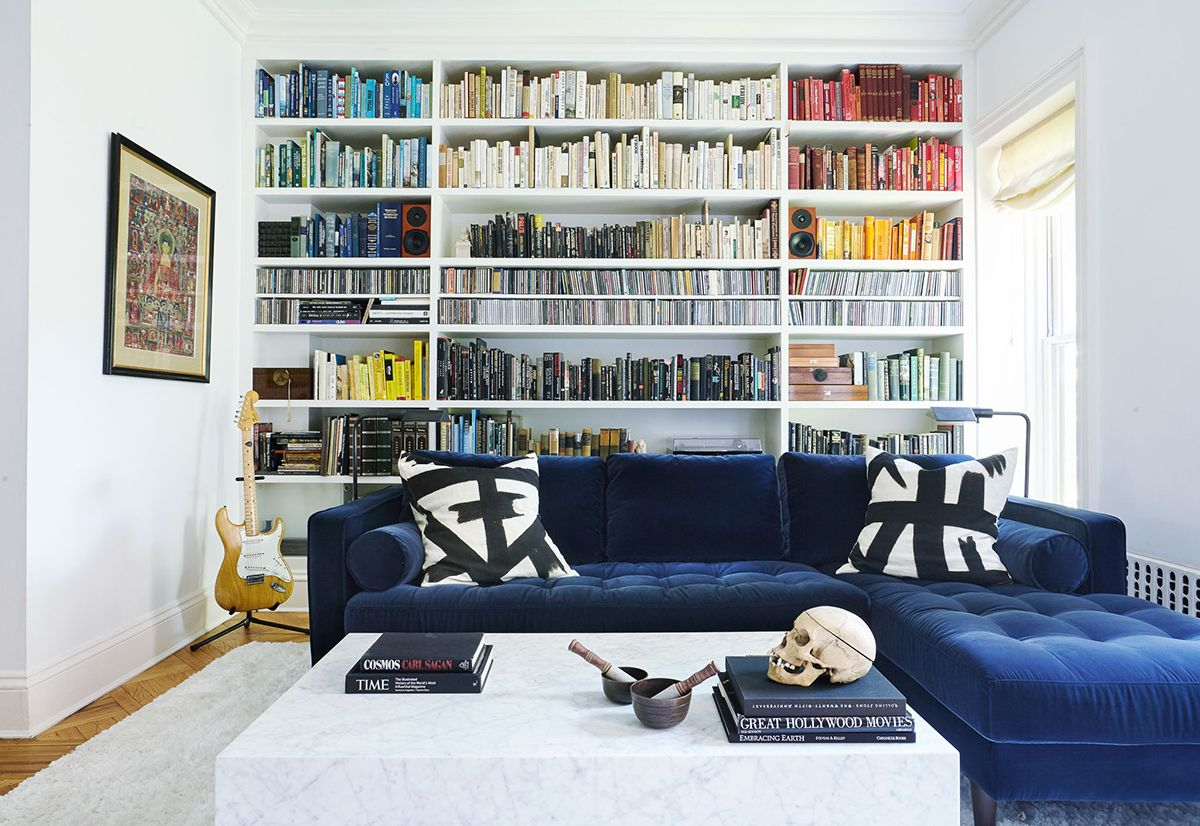 A glamorous brooklyn brownstone organizing white pillows and