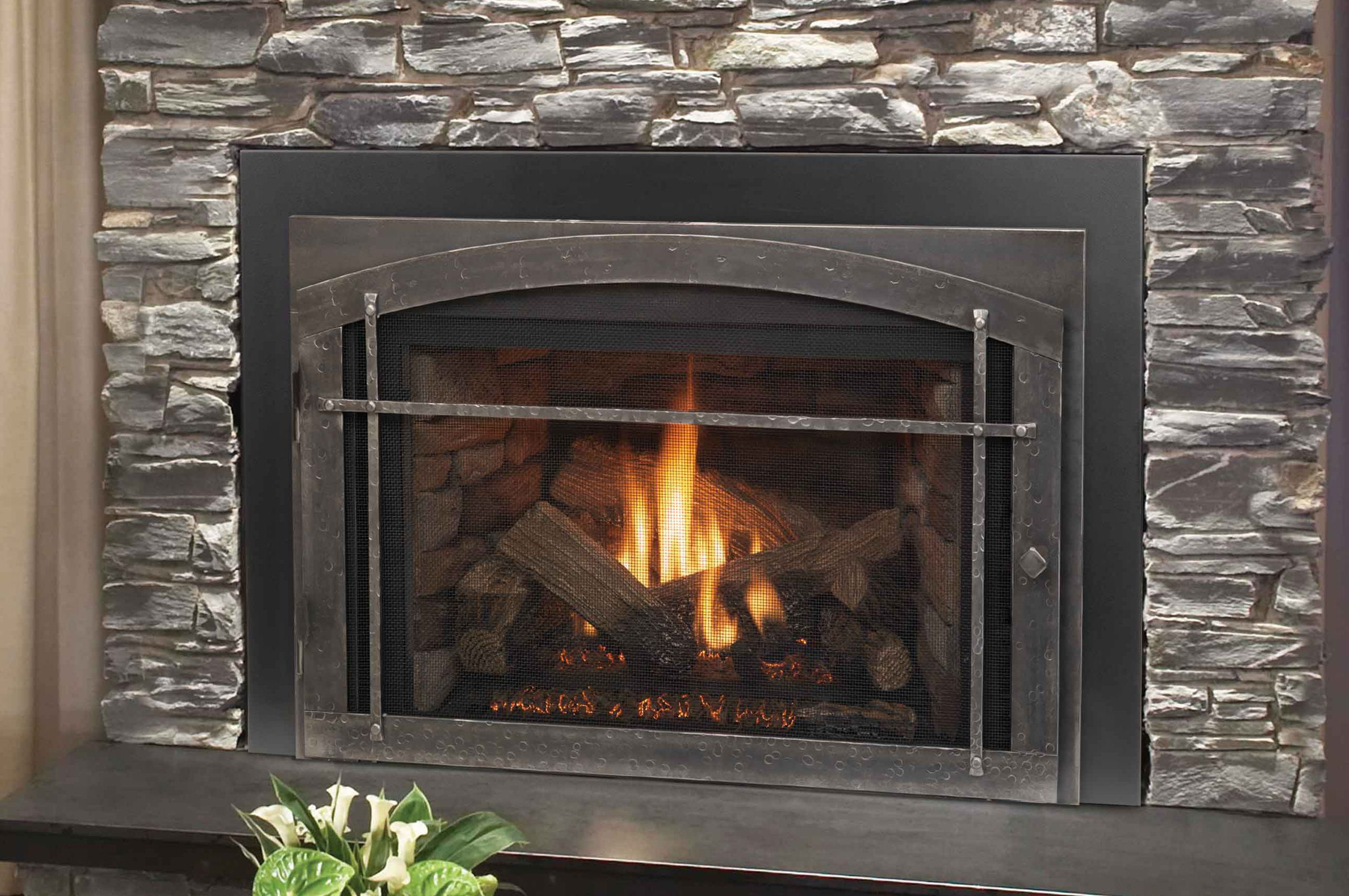 a gas fireplace requires pushing a button often on a remote