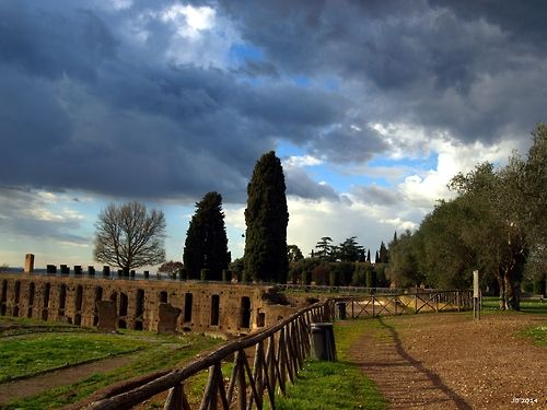 Torn clouds above Villa Adriana, Tivoli, Italy. Photo by Johannes Beilharz, 2014. Olympus SLR, no editing apart from white balance.