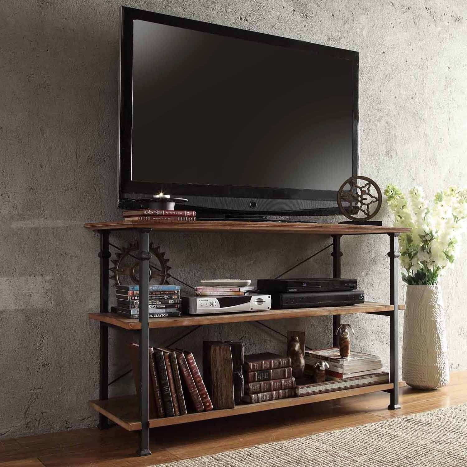 This Myra TV stand has a weathered and timeworn patina allowing traces of  natural wood and