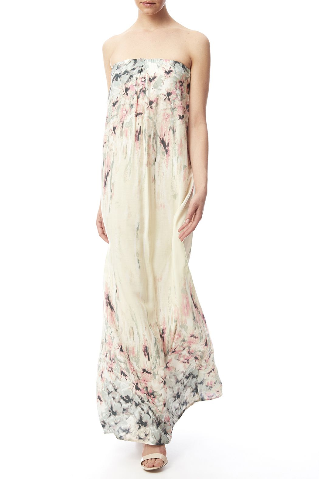 70404a314f0 This printed strapless dress is the perfect piece to pack for your next  vacation! Featuring
