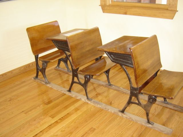 chair connected to desk patio strap replacement really old school desks on bottom iron legs by wooden slats maybe make sure a always had seat closeby