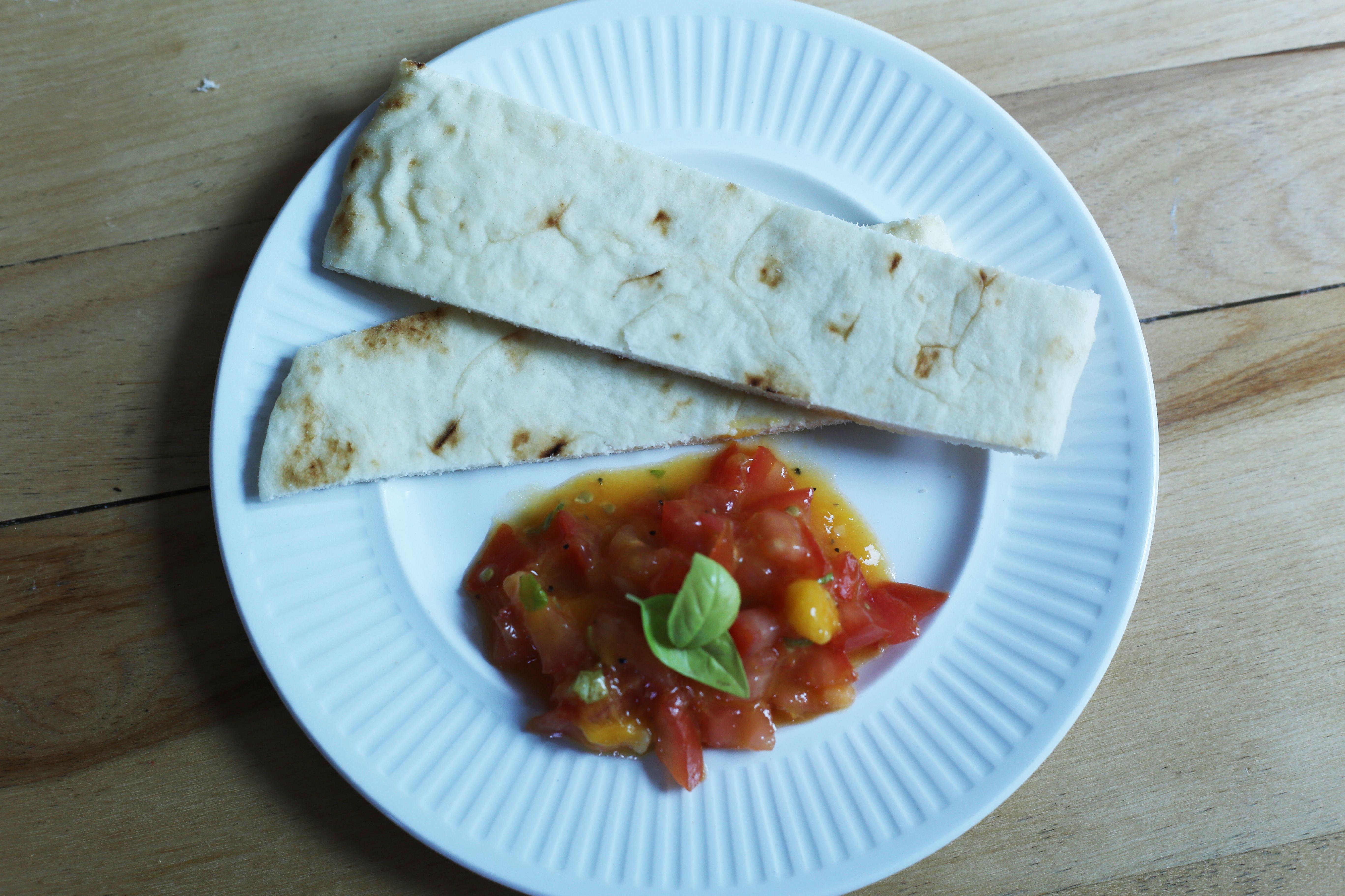 Mango Bruschetta 1 Mango 1 big tomato 1/4 cup of olive oil 1/2 t.s. ...
