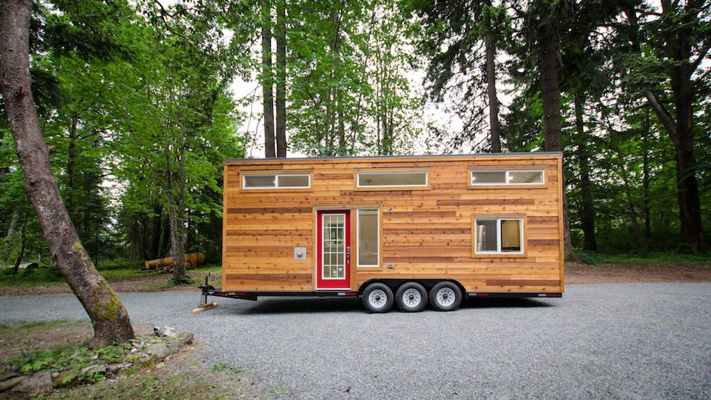 A 28′ tiny house with high end fixtures inside. Built by Rewild Tiny Homes.