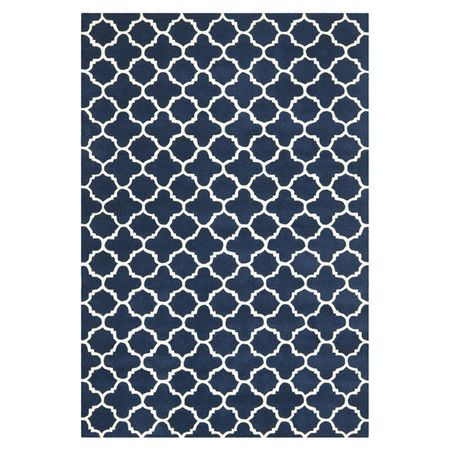 Wool rug with a quatrefoil trellis motif. Made in India.   Product: RugConstruction Material: WoolColor:...