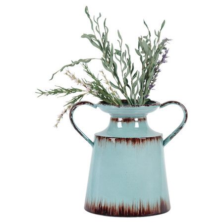 A perfect complement to bright blooms, this distressed metal planter showcases a jug-inspired silhouette and turquoise finish.   Pr...