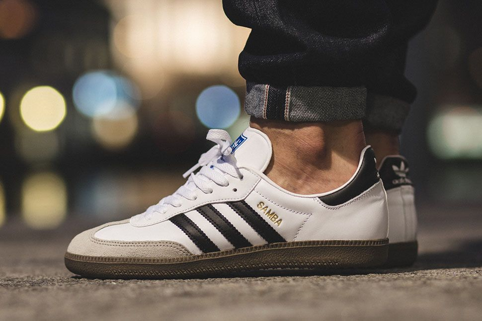 best service 6fe4e 652c0 The adidas Samba is back in focus this season with its return in  black white form on a gum sole. Adding to the lineup is the release of the  football sneake