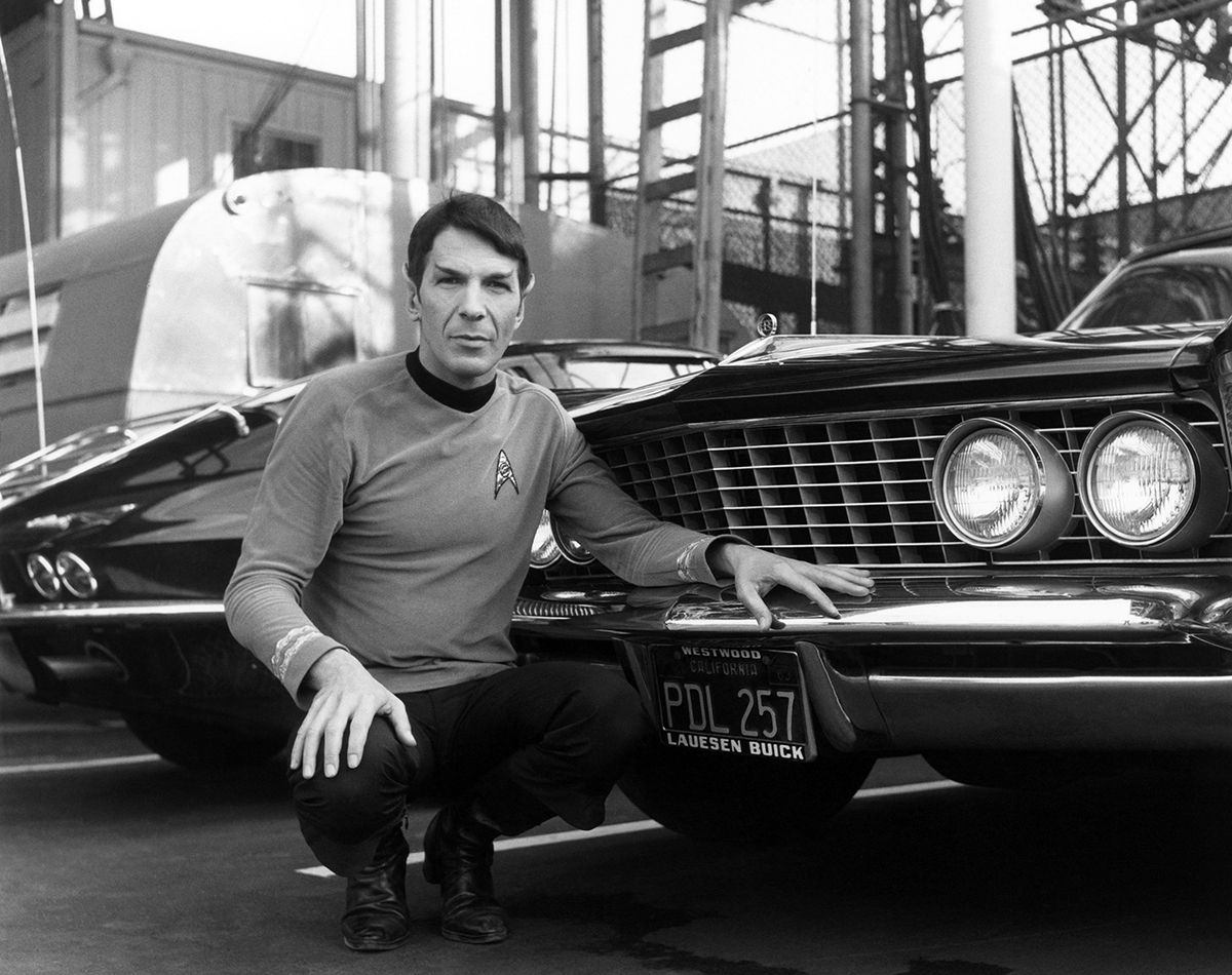 Leonard Nimoy posing in front of his 1964 Buick Riviera ...