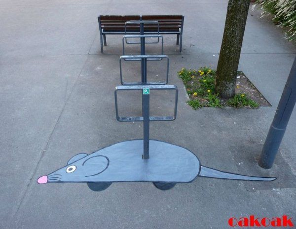 OaKoAk is a French street artist who sees the humorous potential in the most inconsequential everyday objects