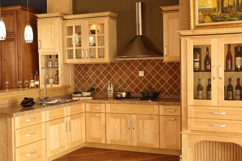I like the natural maple kitchen cabinets with dark inset in ...
