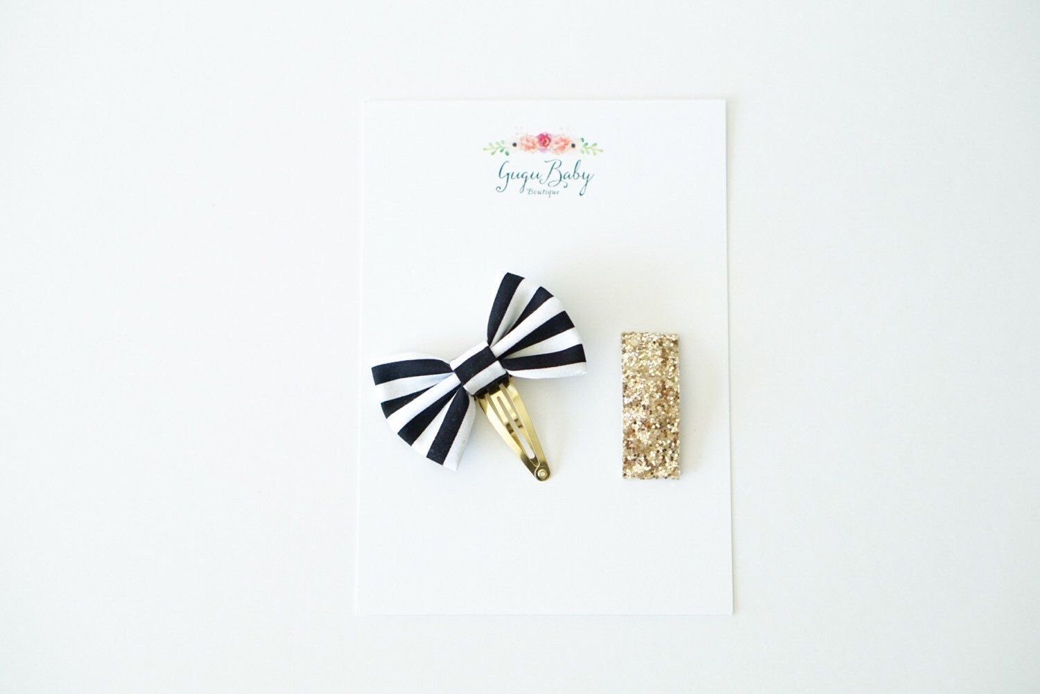 A personal favorite from my Etsy shop https://www.etsy.com/listing/267406464/black-and-white-stripe-snap-clip-set