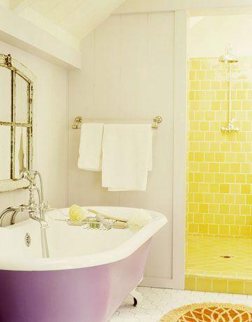 Yellow Shower And Purple Bathtub In A White Bathroom