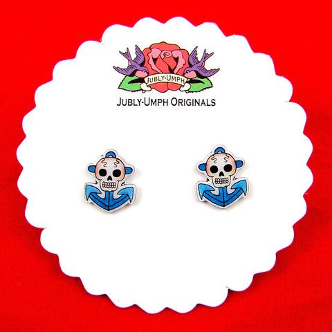 Anchor Skull Stud Earrings:Jubly Umph paints pictures in watercolors and indian ink creating characters with mysterious eyes and curious occupations! These earrings have been created from an original painting and are made from resin and stainless steel. They are little blue anchors with skulls and come on a pretty scalloped card. $15.00