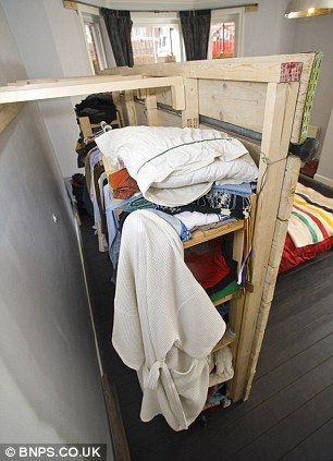The scaffolding board hides a walk-in wardrobe. smaller for our small house