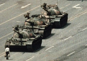 A Chinese Man Stands Alone To Block A Line Of Tanks Heading East