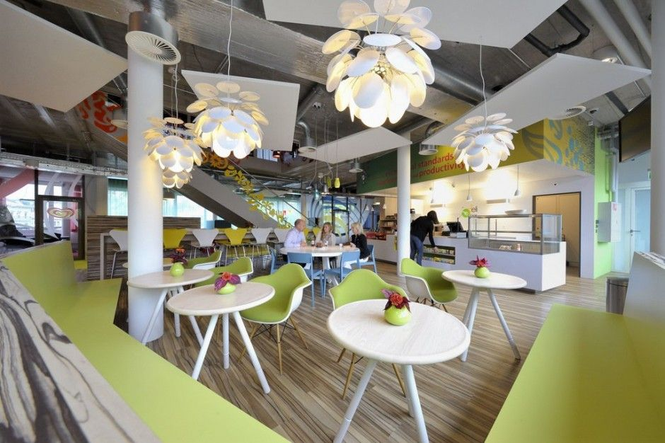 Unilever Office by Camenzind Evolution,  Nice shade of Green, chairs, floor, tables