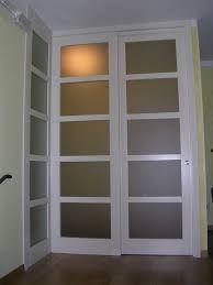 Risultati immagini per porte scorrevoli legno vetro binario ...
