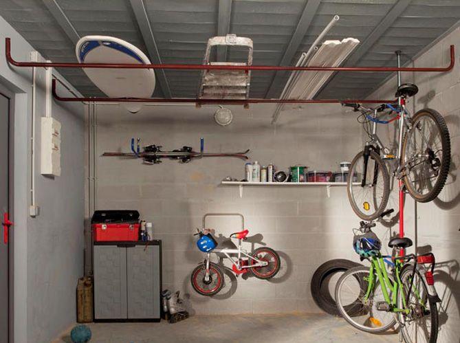 Nos Idees De Rangements Pour Le Garage Elle Decoration Rangement Garage Rangement Au Plafond Garage En Acier
