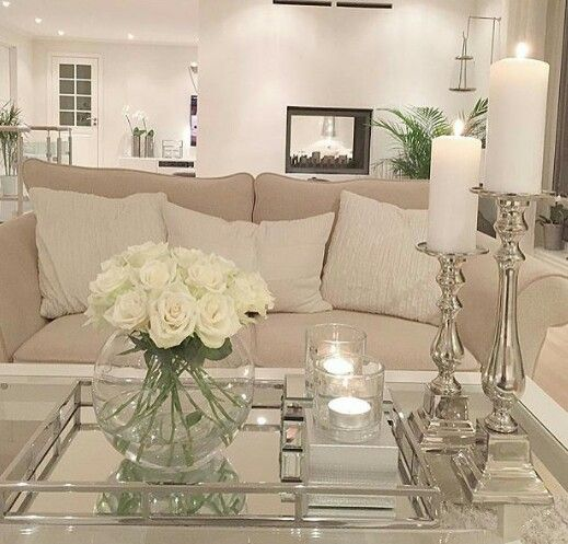 Coffee Table Accents. Glass. Candle Sticks. Fresh Flowers.