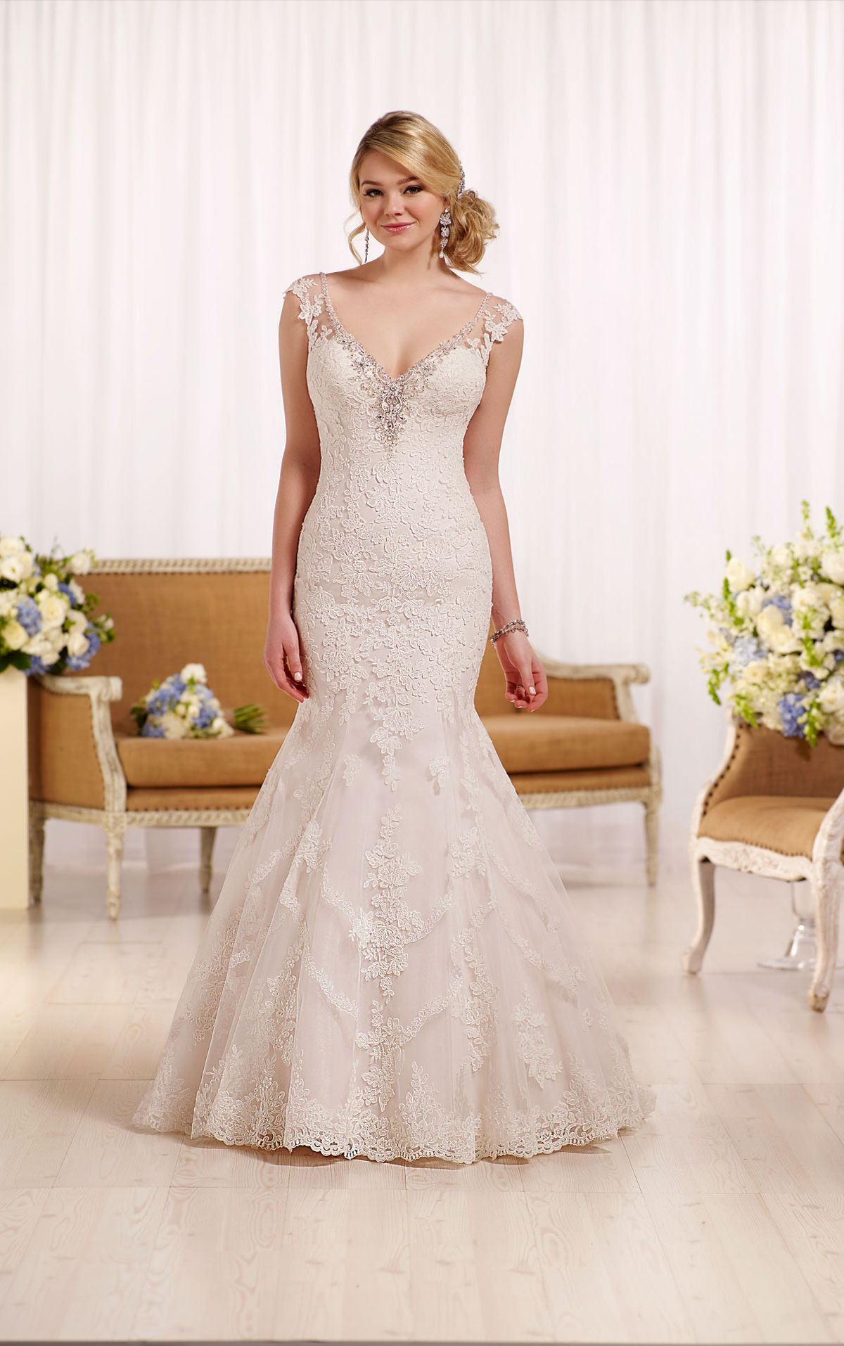 Fit and flare wedding dress with cap sleeves Essense of
