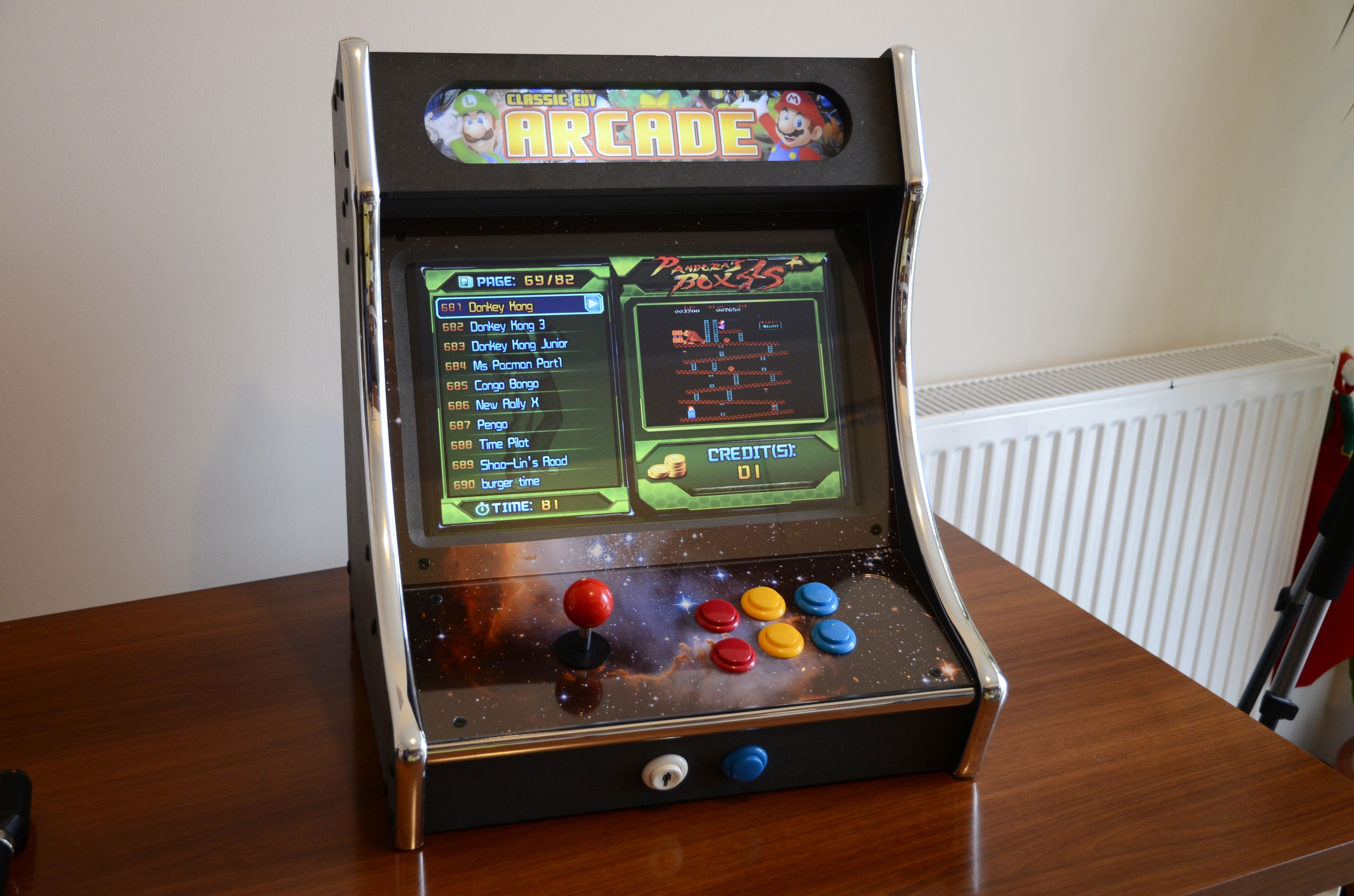 DIY retro bartop arcade cabinet for one players It is powered by