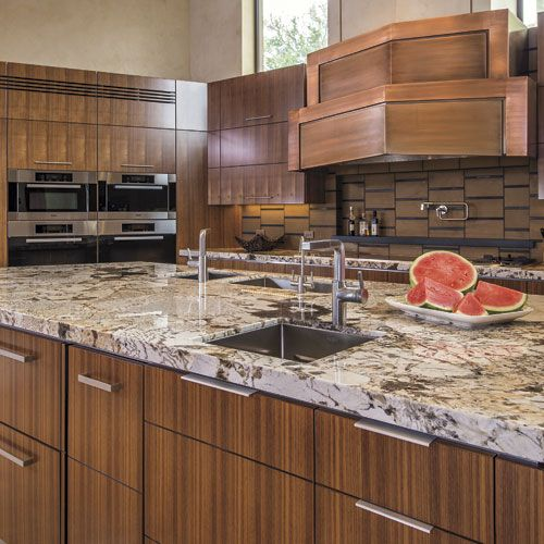 The Kitchen S Prominent Vertical Grain Walnut Cabinets Are Complemented By Venetian Plaster Walls And Ceiling And Copious Nat Kitchen S Kitchen Walnut Cabinets