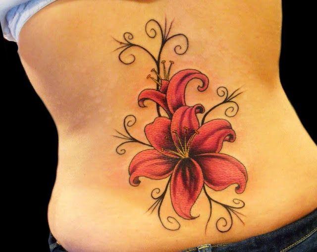 Pretty Gladiolus flower tattoo design on lower back ...