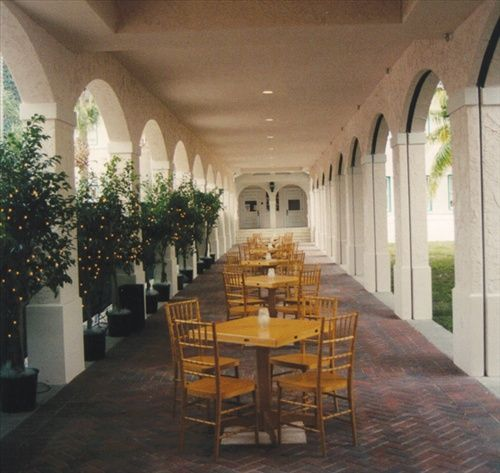 Local Wedding Rentals: Coctail Hour At OSS. See Tables, Chairs, Trees On Left