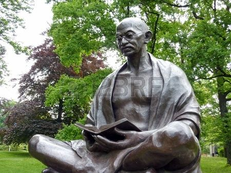 Statue of Mahatma Gandhi sitting and reading a book in Ariana