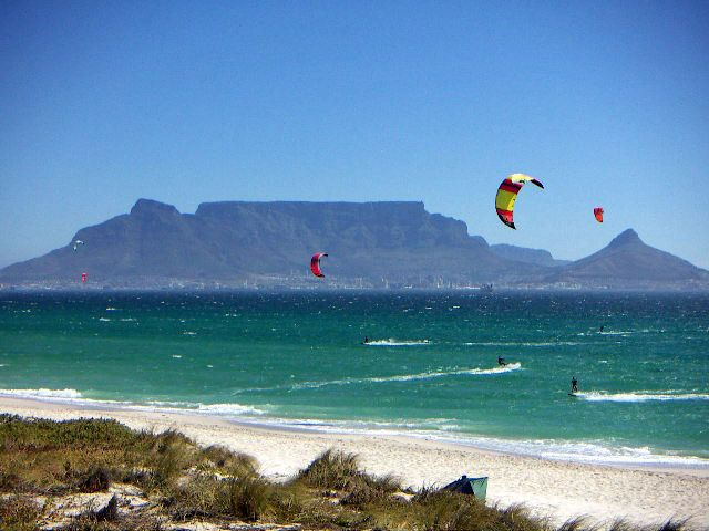 We make the most of the weather by turning the abundant wind into a lifestyle. Here you see kite surfers sailing the skies and the waves with Table Mountain in the background. Taken near Blouberg. #lifestyle #capetown #holiday