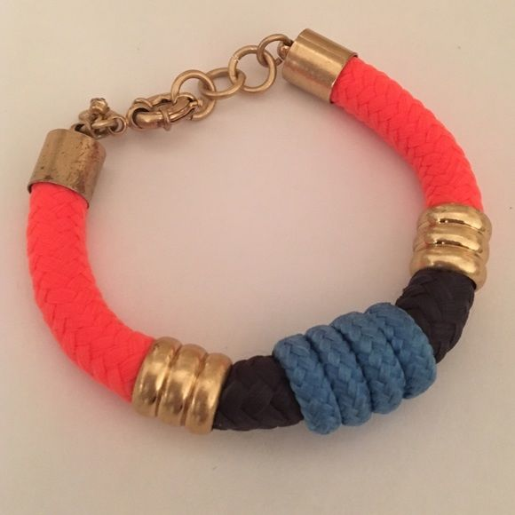 J. Crew Rope Bracelet Cute rope bracelet. Bright orange, navy and light blue. Gold hardware. Adjustable chain clasp with logo charm. Great condition. J. Crew Jewelry Bracelets